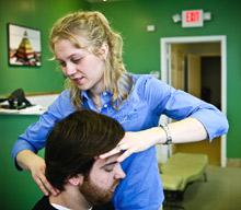 Dr. Hannah adjusting a patient.