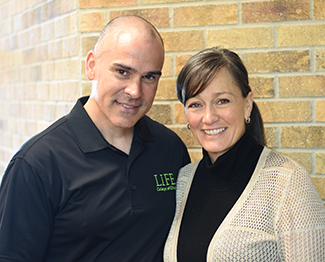 Lansing Chiropractors Dr. Denise Rassel and Dr. Jean-Guy Daigneault