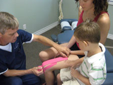 Rock taping a patient.
