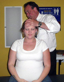 Dr. Mustain adjusting a patient.