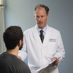 Chiropractor Towson consulting with patient