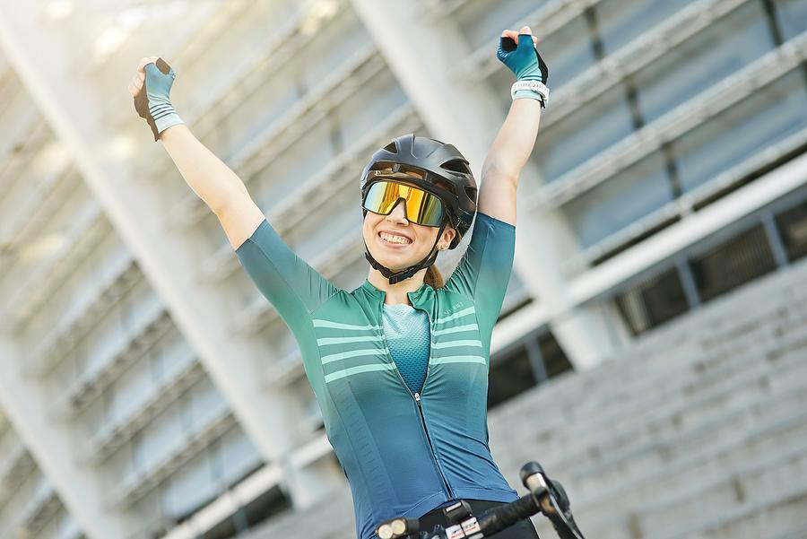 Portrait Of Successful Professional Female Cyclist In Cycling Ga