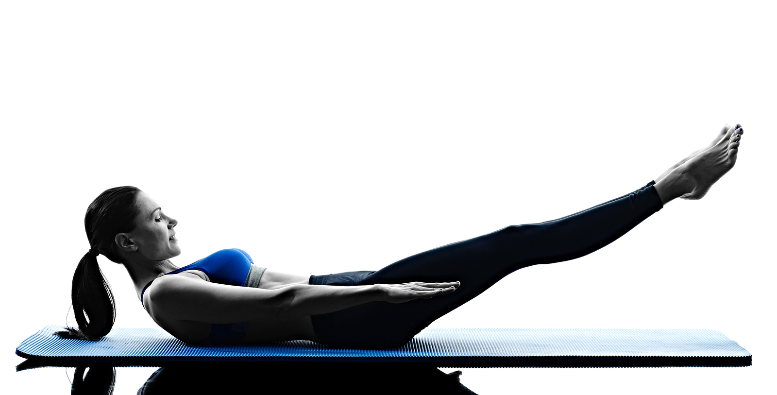 one caucasian woman exercising pilates exercises fitness in silh