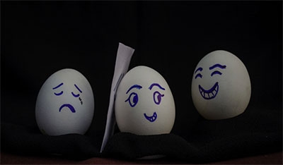 Photo of eggs with various faces drawn on them