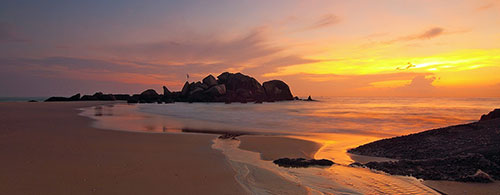 Photo of a beach at sunrise