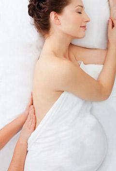 women receiving pregnancy massage