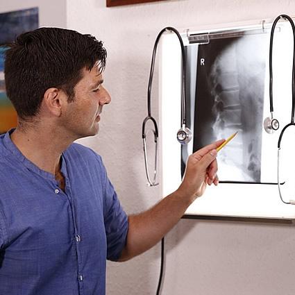 Dr Roddy pointing at x-ray