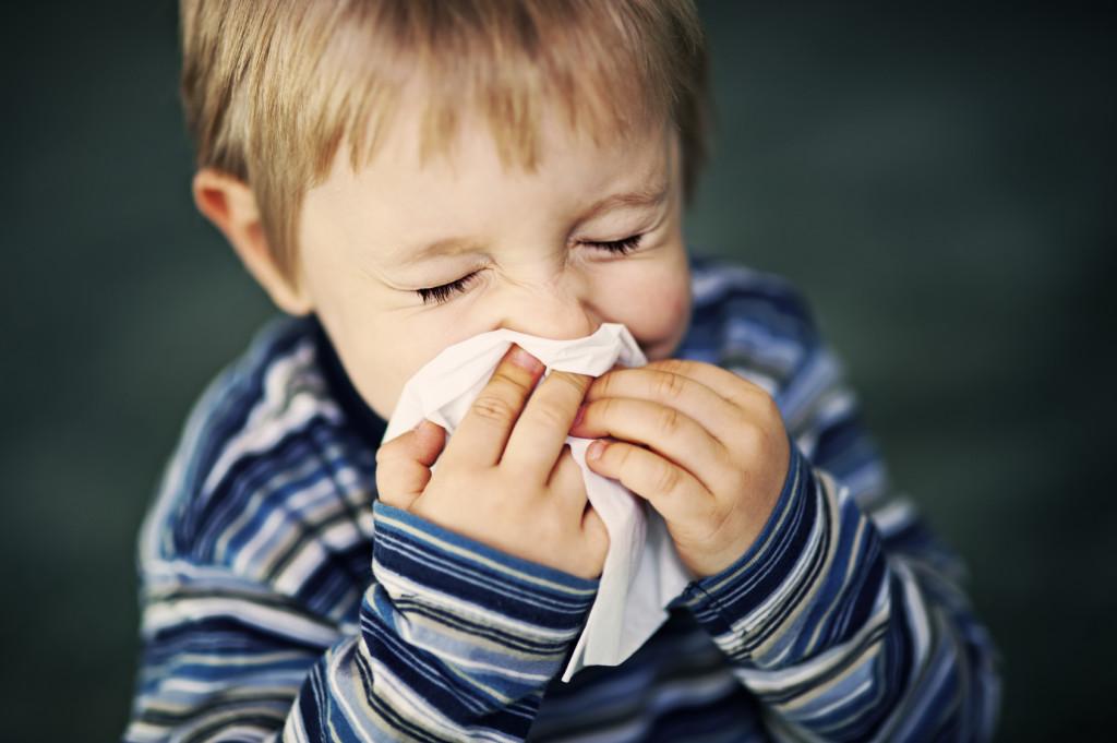 Child sneezing. jpg