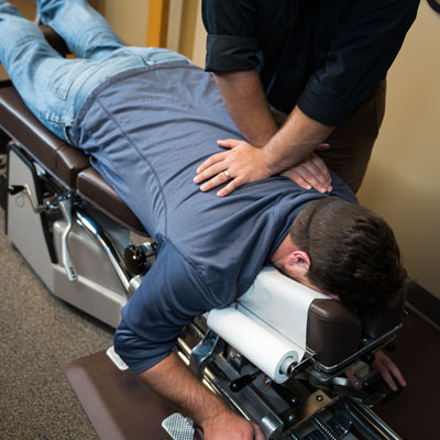Dr. Nafziger performing an upper back adjustment
