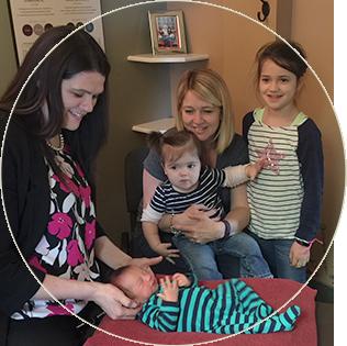 Dr. Tara ajusting newborn