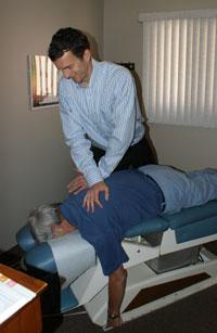 London Chiropractor adjusts patient