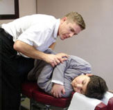 Mississauga Chiropractor of Universal Chiropractic: Adjusting a patient