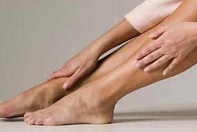 woman touching her feet