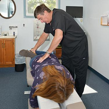Doctor adjusting female patient