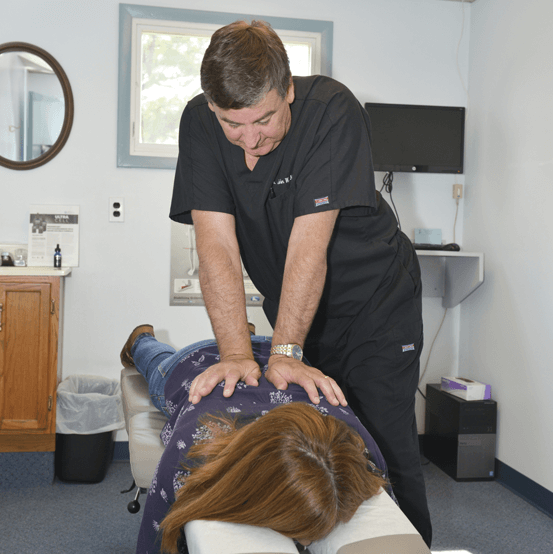 Dr John adjusting woman