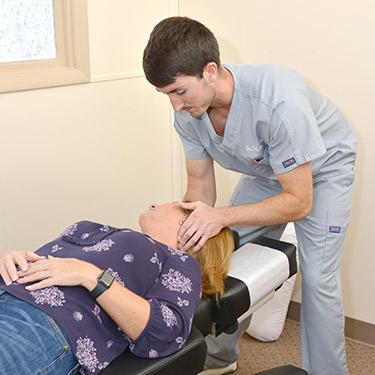 Dr Seth adjusting womans neck