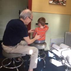 Chiropractor adjusting a child patient