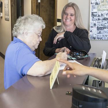 Patient at reception desk