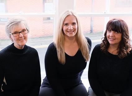 Three female team members