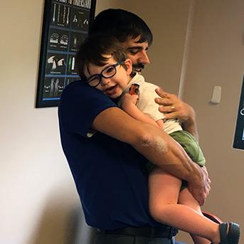 Dr. Athanasios Sarris holding a child