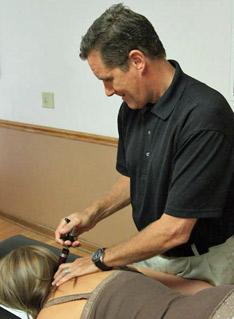 Dr. Stirpe using activator technique.