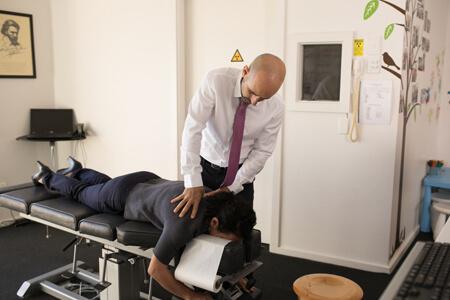 Dr Mario Stefano adjusting a patient