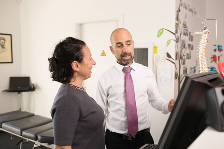 Dr Stefano consulting with patient