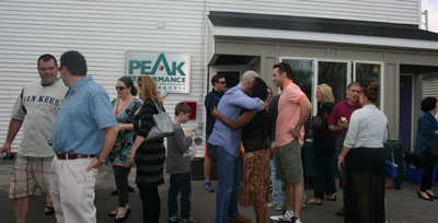 Albany Chiropractor with patients at grand opening