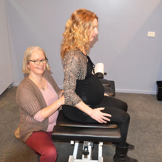 Dr. Kathy adjusting pregnant womans back