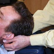 Dr. Moymer adjusting patient.