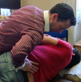 Glanmire Chiropractor, Dr. Kelly adjusting a patient.
