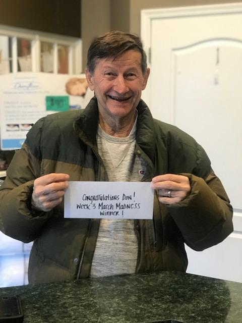Photo of a man holding paper sign