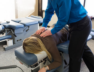 Dr. Jesse giving upper back adjustment