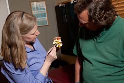 Dr. Lynn holding a spine