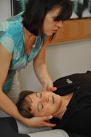 Dr. Graham adjusts a patient's neck.