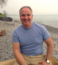 Dr. Roger Karam