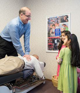 Fresno chiropractor dr daniel anrig adjusts