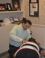 Peoria Chiropractor Dr. Dan Joseph adjusts a patient