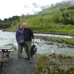 Laura & husband walkin gup a glacier