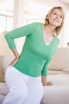 Woman with back pain, Clearwater Chiropractor