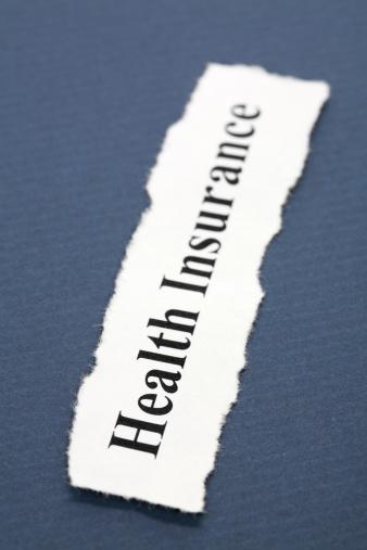 Health Insurance written on a piece of paper