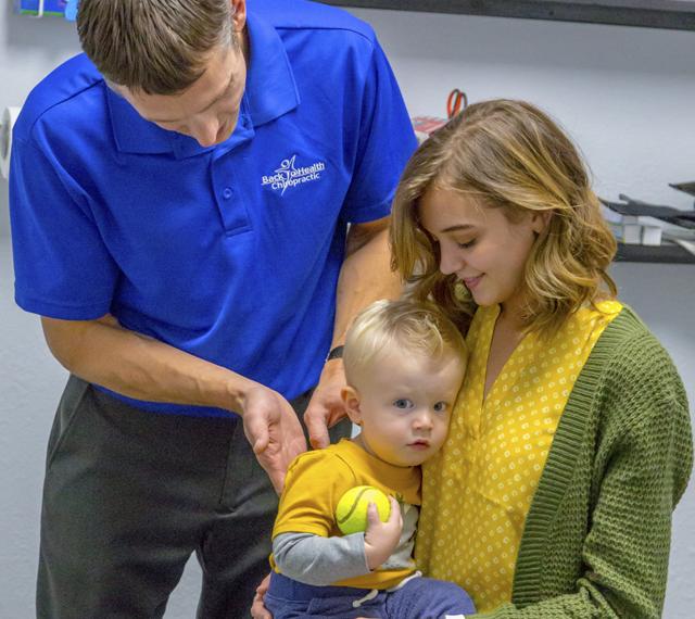 Dr. Derek adjusting baby