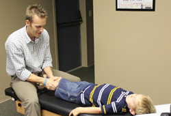 Dr, Howell Adjusting Boy