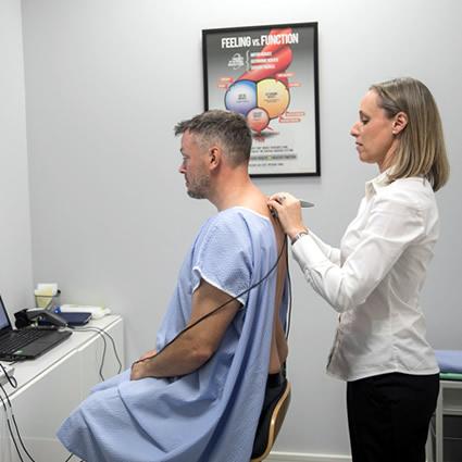 Dr Marie scanning mans back