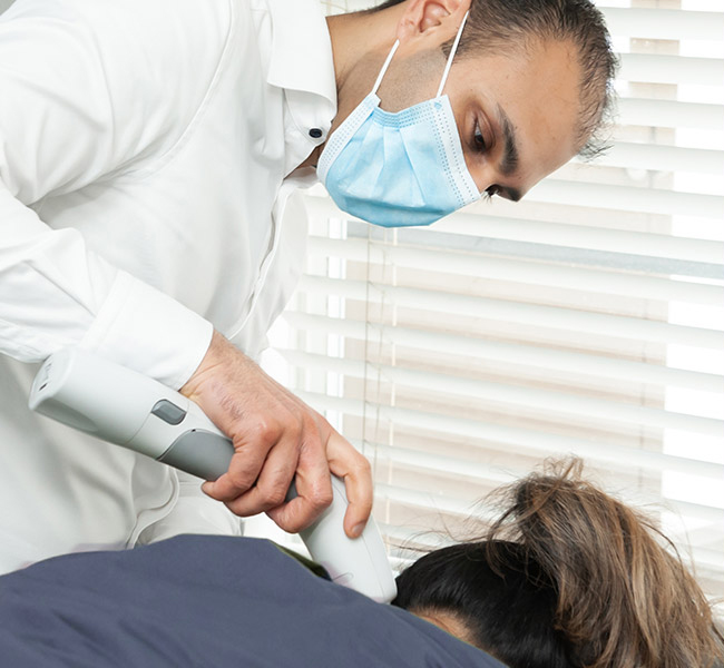 Dr. Alibhai adjusting patient
