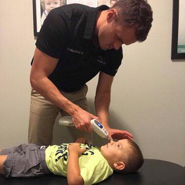 Dr Josh adjusting child
