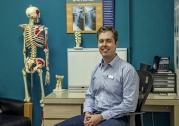 Dr. Tilley sitting at a desk