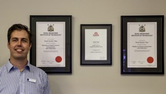 Dr. TIlley with certificates