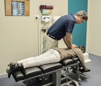 Dr. Tilley adjusting a patient