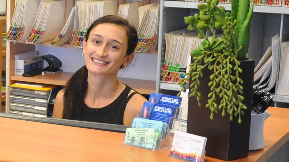 smiling-woman-at-frontdesk